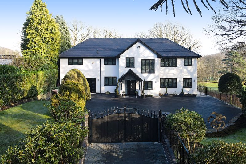 A Detached Family Residence With Views Over The Mere Golf Course
