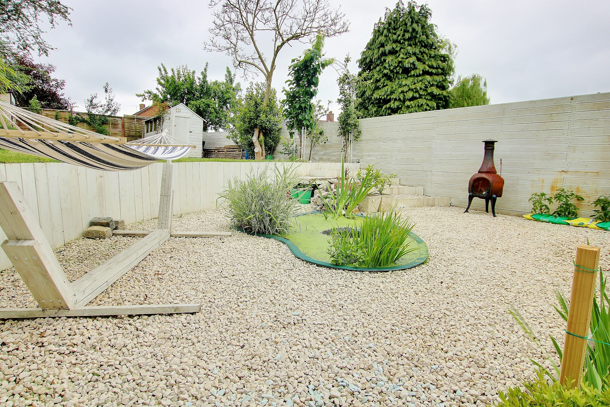 RECENTLY LANDSCAPED GARDEN! BEAUTIFUL PRESENTATION! A MUST SEE!