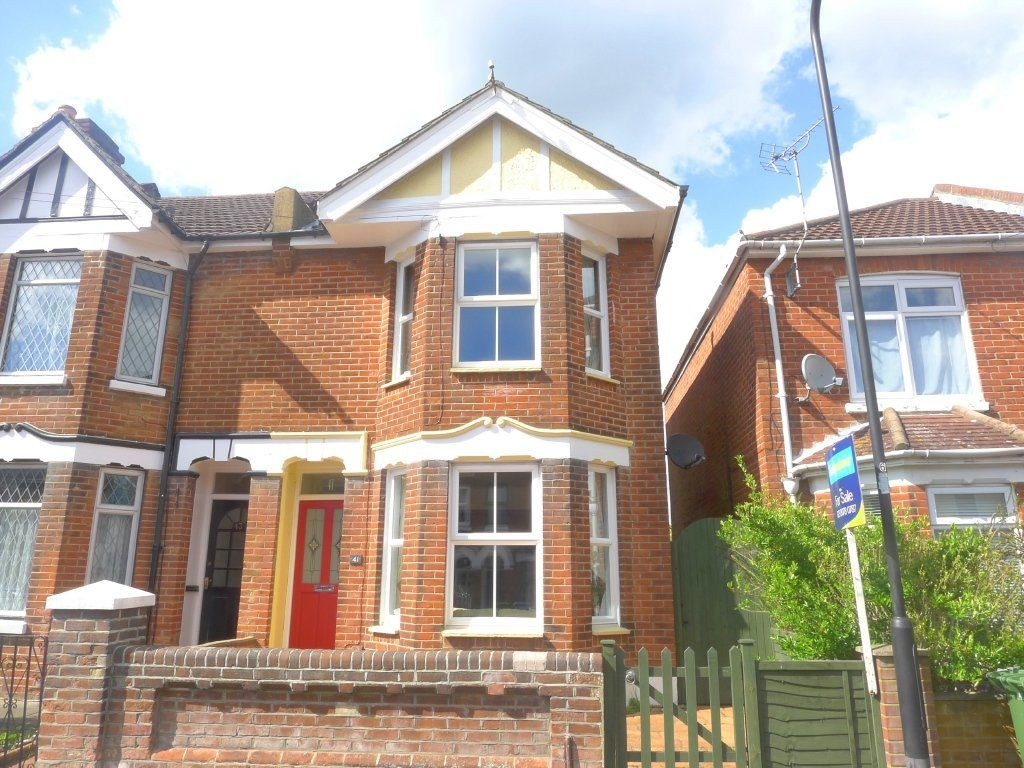 THREE BEDROOM HOUSE WITH PARKING TO THE REAR.